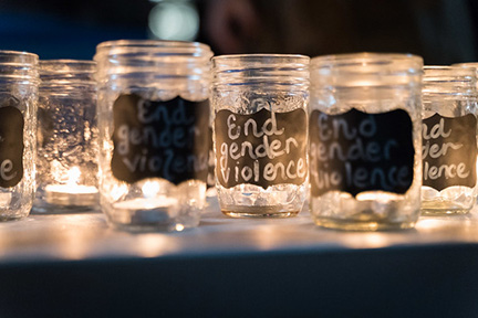 Image of candle that says end gender violence