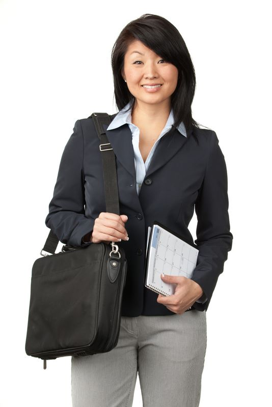 Photo of a woman holding a notebook and satchel.