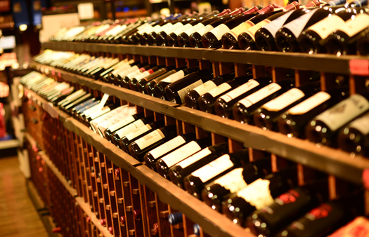 Multiple rows of wine displayed on a rack