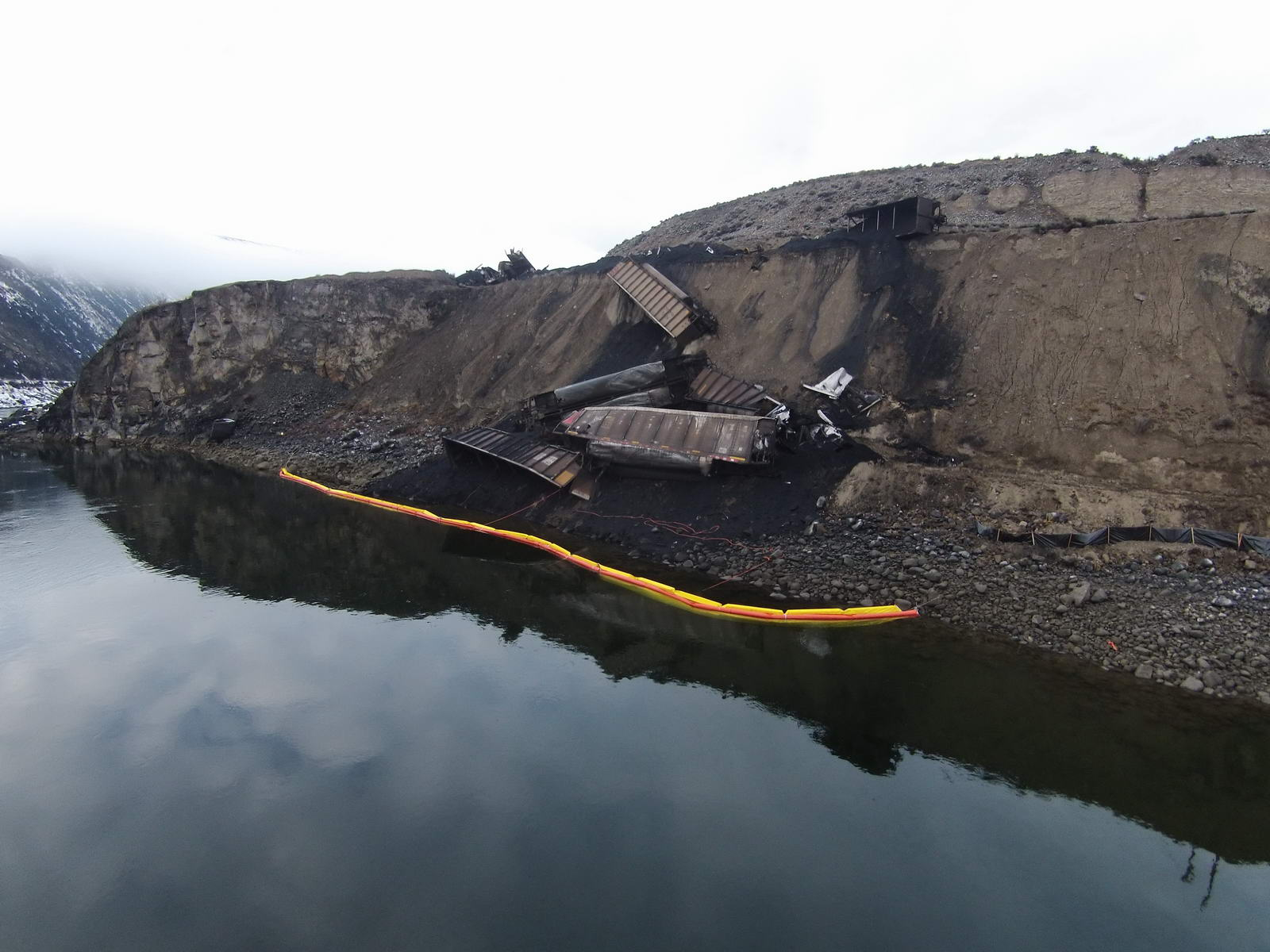 Image of  fuel tanker spill near a river