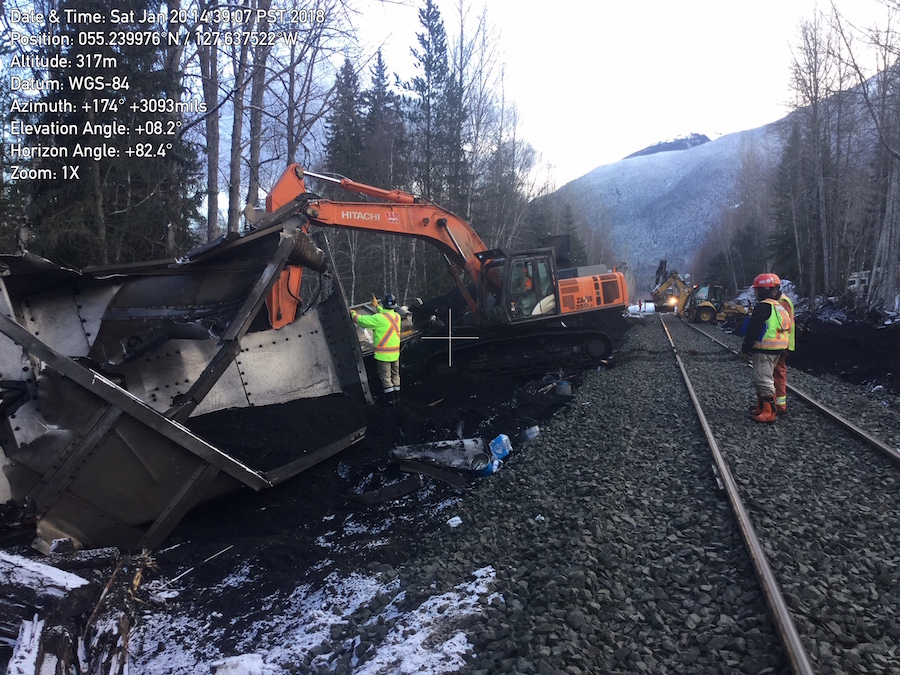 crews work to clean up coal spill