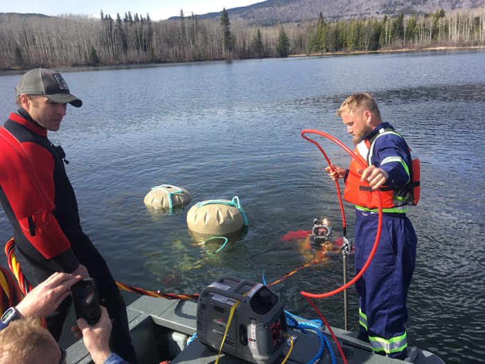 Divers locate and retrieve vehicle from Ross Lake