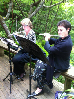 Two flutists performing at Lion's Bay