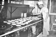 Making pancakes in the cookhouse - Click to zoom